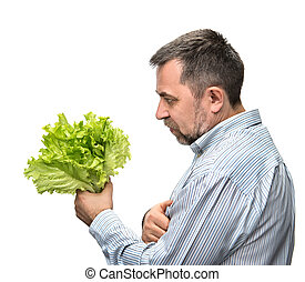 Man holding lettuce isolated on white - Healthy food Man...