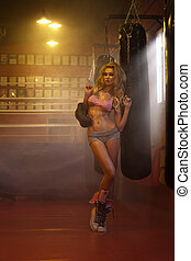 Young blonde female boxer with gloves - Young blonde female...