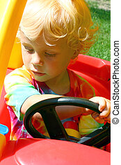 Child Driving Toy Car - a cute little boy driving a toy car...