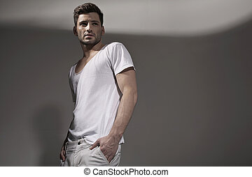 Muscular handsome man wearing spring clothes - Muscular...
