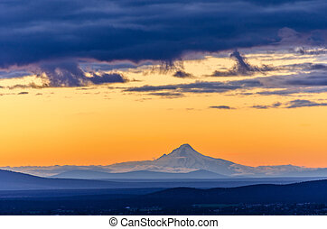 Sunset over Mt Hood - Orange sky over Mt Hood seen during...