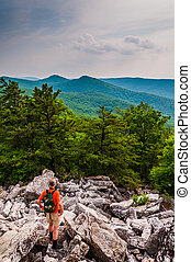 A hiker descends the rocky slopes of Duncan Knob, near Luray...