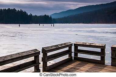 Ice skaters on a frozen lake at Cowans Gap State Park