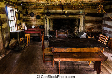 Interior of a historic log cabin in Sky Meadows State Park