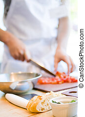 Bruschetta - Kinds in cooking class making bruschetta.
