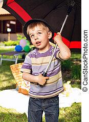 Curious boy with big umbrella