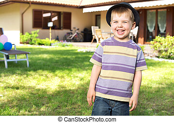 Happy little boy laughing to the camera