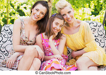 Three happy women smiling to the camera