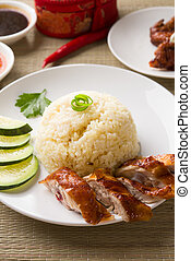 singapore roasted chicken rice  with chili sauce as background