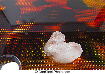 Quartz Crystal - A quartz crystal against a colorful...