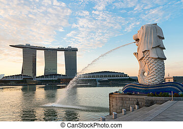 Singapore modern landmarks at dawn - Merlion and Marina Bay...