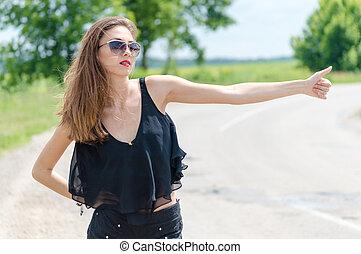 Beautiful hitch hiker - Beautiful young woman hitch hiker at...