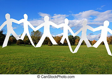team of paper people in the park - team of paper people...
