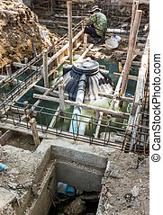 Septic tank installation at construction site