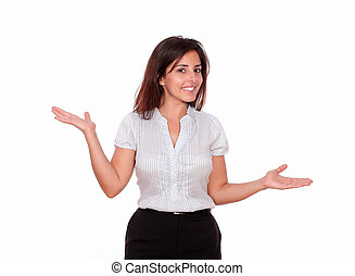 Smiling woman looking at you with palms up