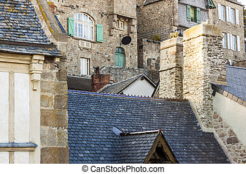 Roofs and houses from the village under the monastry on the...