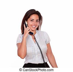Smiling hispanic woman talking on phone