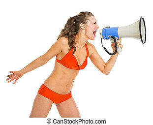 Young woman in swimsuit shouting through megaphone
