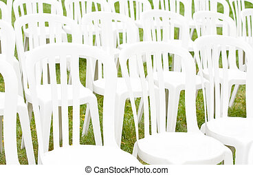 Special Occasion Chairs - A Grouping of White Chairs for a...