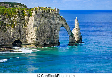 Etretat Aval cliff and rocks landmark and blue ocean ....