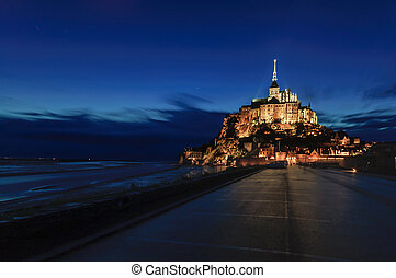 Mont Saint Michel monastery and bay landmark night view. Normandy, France