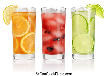 Summer drinks with ice, fresh berries, lemon and lime...