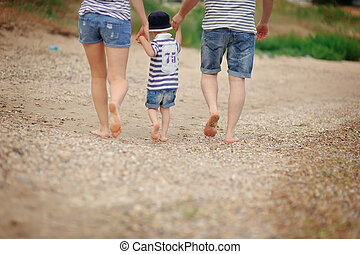 bare feet - walk on the beach in the sand bare foot family