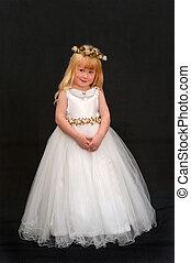 Flower Girl - Pretty young girl dressed in formal dress