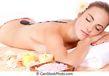 young attractive woman hot stone massage wellness isolated...