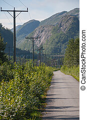 Power lines on mountain road.