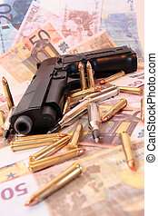 gun crime 26 - gun bullets and money showing a dangerous...