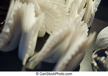 Abstractly folded white napkins