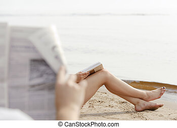 Woman feet in sand on the beach - Man watching legs of a...