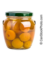 Glass jar with preserved apricots on the white background