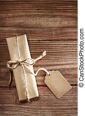 Gift box on rustic wooden table - Rectangular present with...