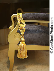 decorative tassel - golden tessel on decorative chair in...