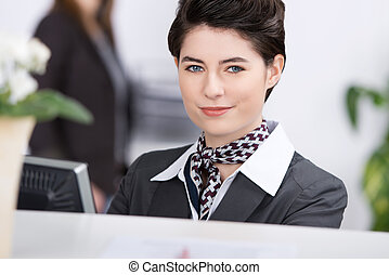 Confident Young Receptionist At Reception - Closeup portrait...