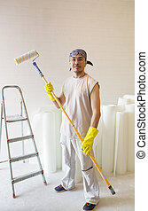 worker standing with painting roller