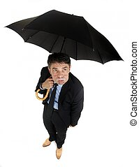 Morose businessman eyeing the weather - Humorous high angle...