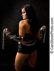 Modern slavery - Pretty sexy woman with long metal chain