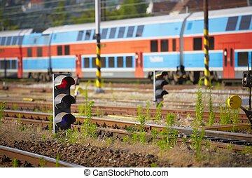 Stoplight - Traffic light shows red signal on railway -...