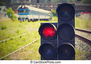 Stoplight - Traffic light shows red signal on railway -...