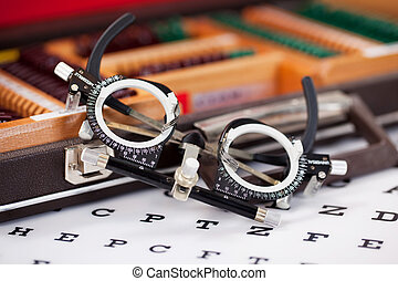 Eye Examination Glasses On Snellen Chart - Closeup of eye...