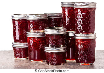 Fresh strawberries preserved in jars as homemade jam and...