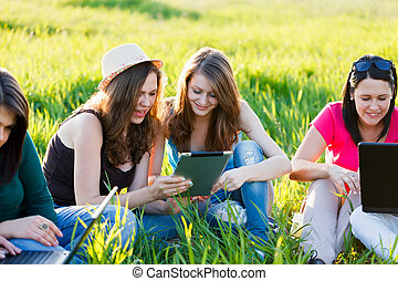 Girls With Thier Tablet Outdoors