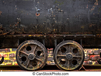 Wheels of a mine cart closeup photo