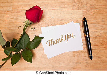 Thank You Card, Pen and Red Rose on a Wood Background