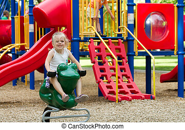 Smiling kid on the playground - Child having fun and smiling...