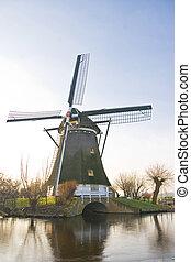 Dutch windmill in polder winter landscape