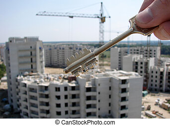 Key in a hand on a background building...